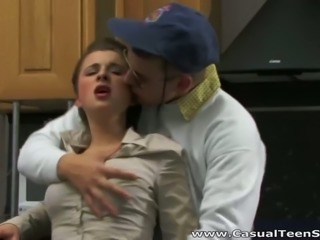 Young housewife gets her pussy rammed hard in the kitchen