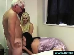 Two bad British girls sucking CFNM guys cock
