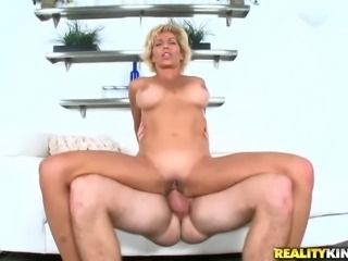 Stacked MILF with long beautiful legs is enjoying every second of sex