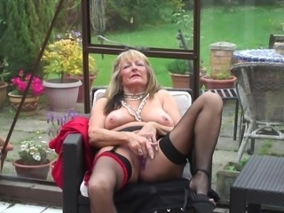 Busty British mature babe strips in seamed stockings