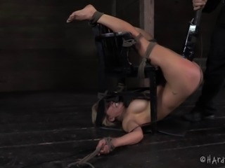 Blonde beauty is captured and punished in a rough BDSM way
