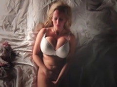 Huge tits blonde plays with herself