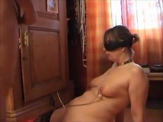 cumshot on bondaged titties