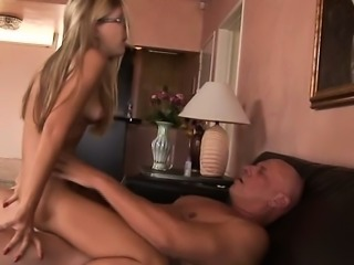 A stunning spectacled blonde rides this big hard dick so well