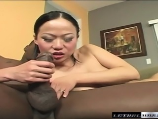 Charming Asian girl in stockings Niya Yu gets hammered by a black stud