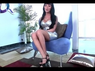 Gorgeous latin shemale stroking her huge huge cock