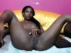 Slender black beauty with sexy long legs gently rubs her pi