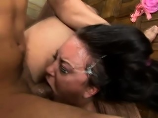 Trashy brunette with lovely titties has a big pole invading her throat