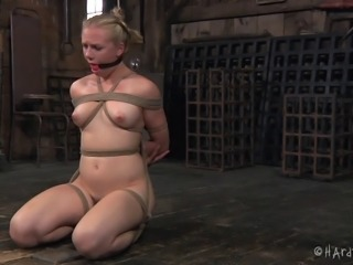Sweet looking babe Tracey is tied up and penetrated with the sex toys