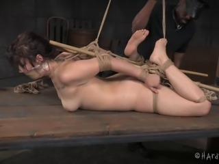 Submissive in stockings tied up tight and bent painfully