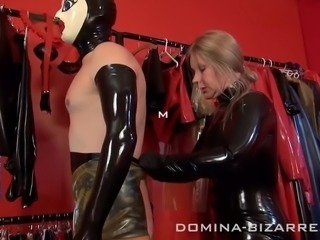 Lady Mercedes likes to transform Slaves into  Rubberdolls. She puts the rubber mask with those big dolly eyes on him, then she pulled him into rubberstockings and high heels. his mouth is sealed Femdom, German, Slave, Extreme, Transformation