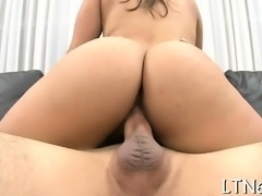 Charming hotty is having a wild time engulfing a thick cock