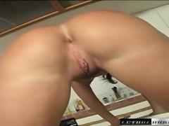 Slender brunette milf gets her juicy peach drilled hard in the kitchen