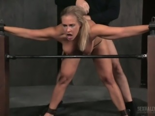 Two perverts fuck restrained sexy whore Angel Allwood in doggy position
