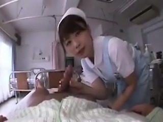 Naughty Asian nurse removes a patient's robe to give him a