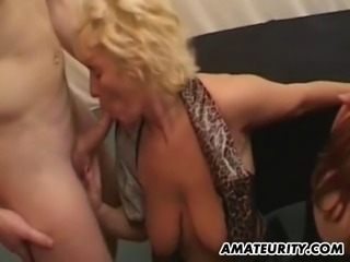 2 naughty amateur Milf suck and fuck a huge amount of dicks in this hot...