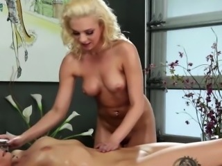 Lesbians make out in the massage table