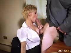 Seductive police woman wearing sexy lingerie and stockings sucks gigantic...