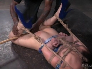 Attacking Amy's private parts is easy since she's tied up!
