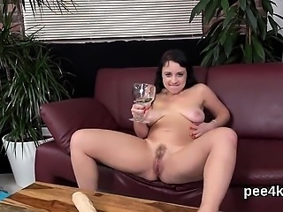 Striking nympho is pissing and rubbing shaven cunt