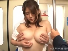 Affectionate Japanese pornstar in sexy bra getting her boobs caressed in the bus