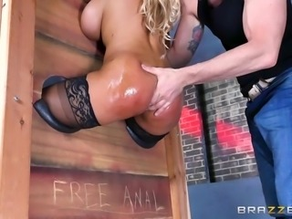 Spanish sex bomb Bridgette, is locked in the stock with her tasty bum sticked out. This makes it easy for her master to rub oil all over those spectacular cheeks. Her rectum is stuffed with his gigantic cock and stretch out wide.