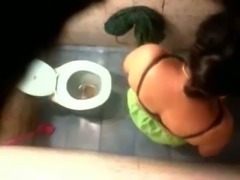 Hidden cam in the toilet room catches Indian milf wife