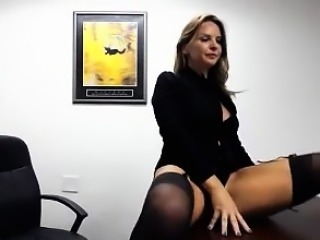 Provocative blonde secretary displays her divine body in th