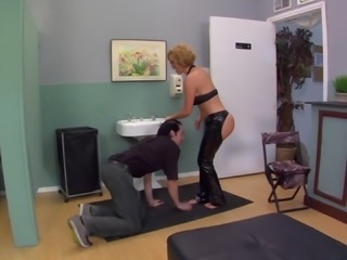 A mistress in leather makes her slave eat her ass out