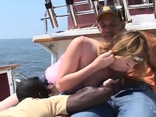 Blonde cutie with a lovely ass has sex with two black guys on a boat
