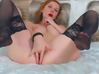 Redhead teases her nylon soles while fingering her pussy