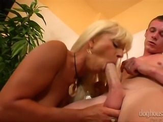 Saggy tittied blonde gives deepthroat blowjob in the bathroom