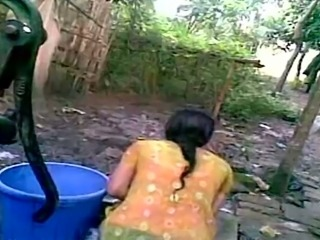 Indian village girl is changing her clothes outdoor