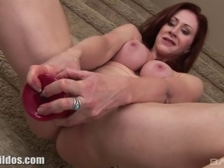 Mature lady groans as she soaks a gigantic dildo down her butt hole