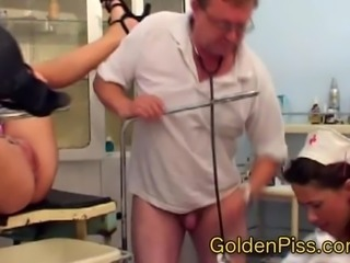 Doctor pissing on nurse and female patient