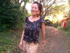 Busty Japanese pornstar swallows cum after giving a tit job outdoors
