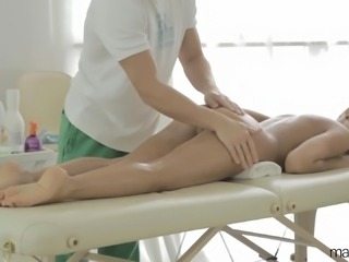 Brunette is massaged and then she gets cock in her mouth and twat