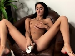 Sexy slim brunette with tiny titties fingers and toys her fiery peach