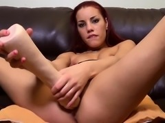 Sexy brunette strips down and uses a huge toy to fist her cunny