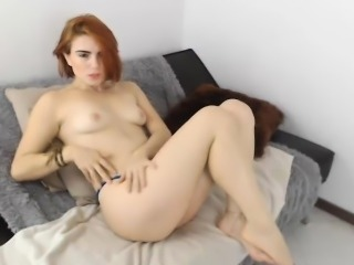 Sultry redhead loses her clothes and lets her imagination t