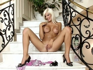 Silver-blonde beauty with perky boobs gives in to her desire on the stairwell