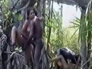 Two couples having sex and switching partners in the woods