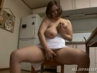 Japanese mom Reiko Yumeno enjoys playing with her huge boobs and vag