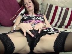 Lovely matured granny posing seductively while masturbating