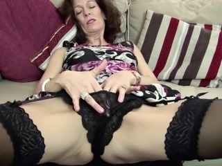 Lovely matured granny posing seductively while masturbating