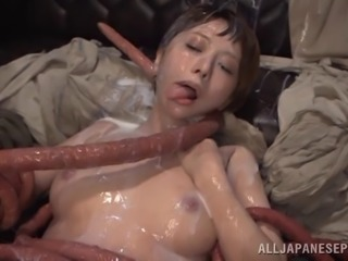 Short-haired Japanese hussy Elly Arai gets fucked by a monster