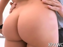Round booty of a hottie is getting covered with oil