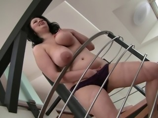 Cougar with big tits rides a black cock in an interracial scene