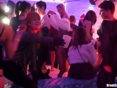 Lesbian dancing and strapon fun at a packed night club