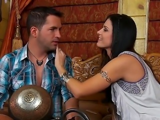 Raven haired beauty  India Summer makes a romantic scene with her lover. She is kissing her man and is then having her pussy fingered. She is really in the mood to make love.